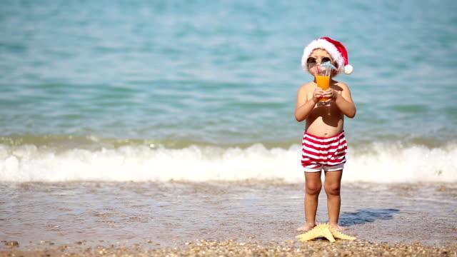 Boy Santa Claus resting on the sea