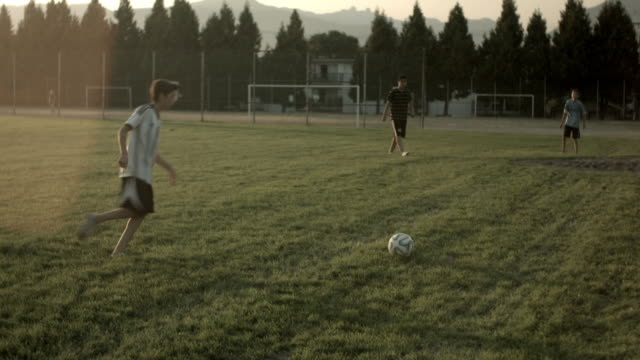 Boy Scores a Volley Soccer Goal from a Cross or Pass made by Boy Wearing Messi Shirt