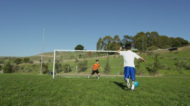 boy scores soccer goal - ゴール点の映像素材/bロール