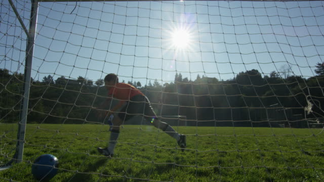 Boy scores soccer goal