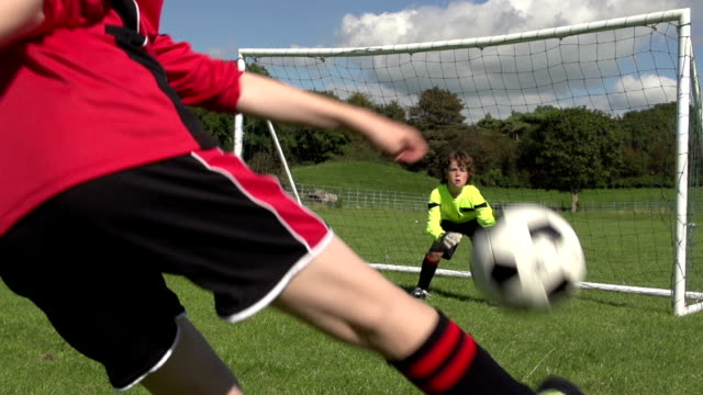 boy scoring amazing volley goal in kid's football / soccer - scoring a goal stock videos and b-roll footage