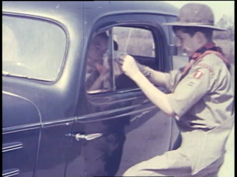 boy scout checking a driver's license / boy scouts helping to unload a truck - boy scout stock videos & royalty-free footage