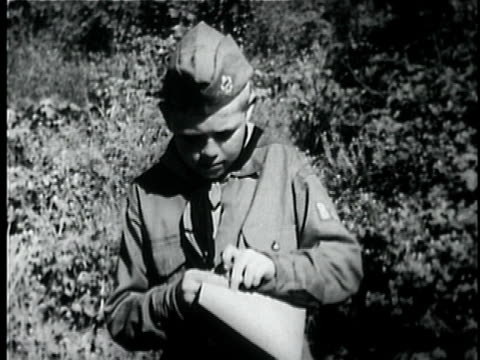 b/w ms boy scout reading map and checking compass, then walks away / usa - boy scout stock videos and b-roll footage