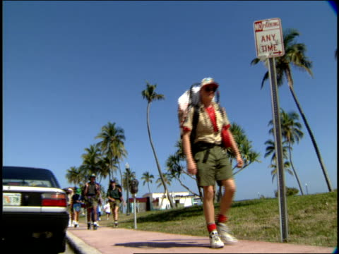 boy scout troop walking down the street with camping gear in miami - pavement stock videos & royalty-free footage