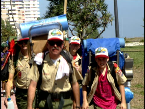 boy scout troop walking down the street with camping gear - boy scout stock videos & royalty-free footage