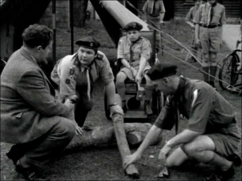 greater london eastcote ext tommy hoare in wheelchair hammering tent peg into the ground / disabled boy in wheelchair with camera / tommy entering... - boy scouts of america stock videos and b-roll footage