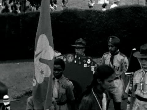 nairobi ext shots of band marching leading scouts and guides of all nationalities / ms scouts carrying scouts gone home sign a circle of purple cloth... - boy scouts of america stock videos and b-roll footage
