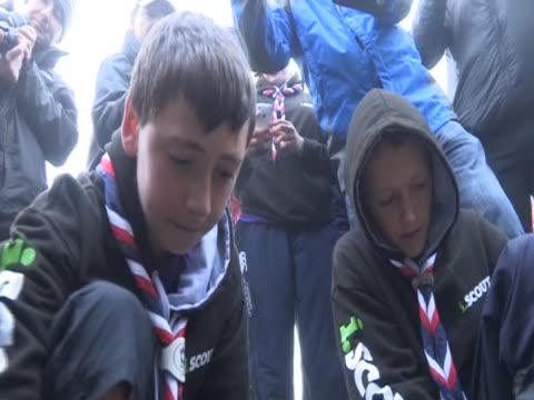 boy scouts from northern ireland attempt to strike a flame to light a torch for the paralympics. - boy scout stock videos & royalty-free footage