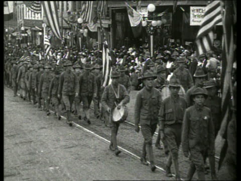 boy scouts marching past camera in parade / vicksburg, mississippi / no sound - boy scout stock videos & royalty-free footage