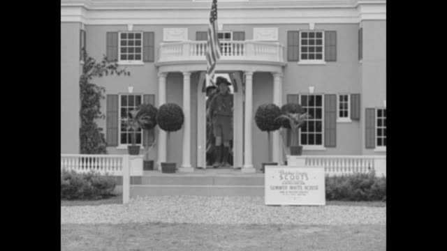 Boy Scouts walking out of front door of replica of President Franklin Roosevelt's Hyde Park house Springwood / Note exact day not known