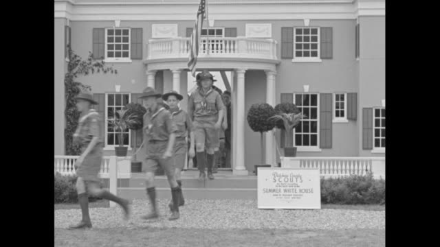 boy scouts walking out of front door of replica of us president franklin roosevelt's hyde park ny house springwood / scouts play leap frog / cook... - us president stock videos & royalty-free footage