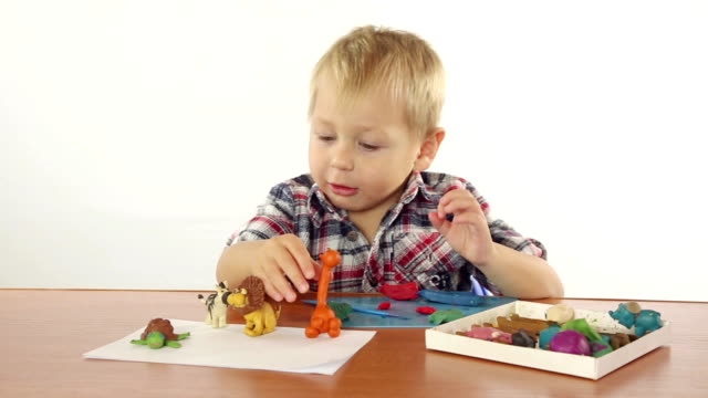 Boy sculpts from plasticine figurines