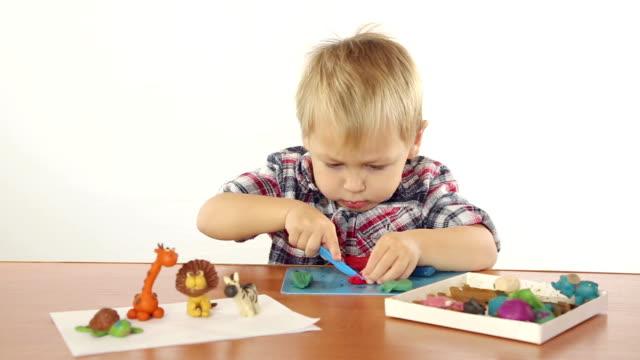 Boy sculpts from plasticine
