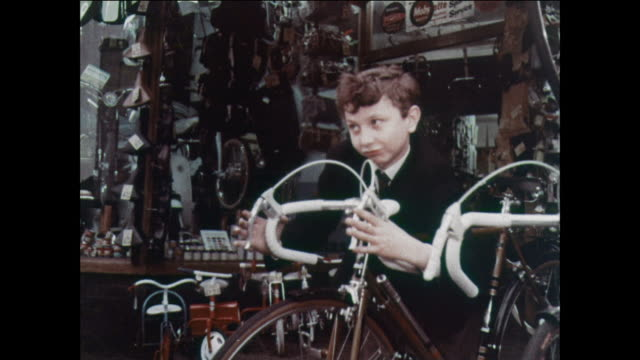 montage boy selects bicycle without guidance from vendor / uk - school bell stock videos & royalty-free footage