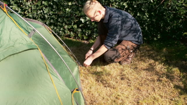 boy setting up tent - one teenage boy only stock videos & royalty-free footage