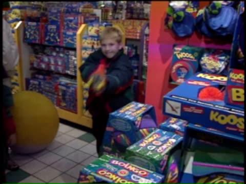 boy shooting nerf gun on december 24, 1995 in chicago, illinois - gun stock videos & royalty-free footage