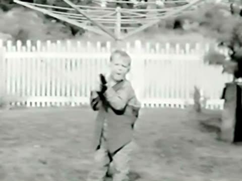 MS Boy (8-9) shooting play gun toward camera / Bend, Oregon, USA
