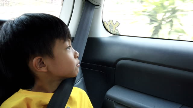 a boy sitting in car with safety belt - belt stock videos & royalty-free footage