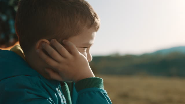 boy sitting in front of the tent on top of the mountain - child stock videos & royalty-free footage