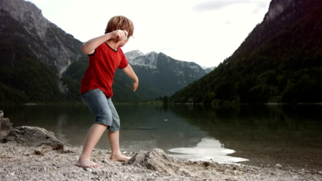 hd slow motion: boy skimming stones - throwing stock videos & royalty-free footage