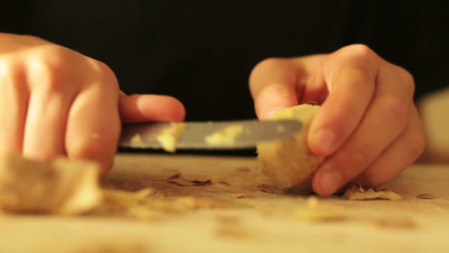 Boy slicing ginger