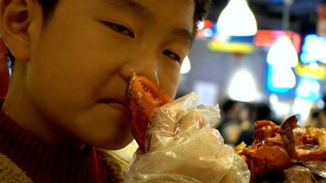 boy smelling baked lobster with cheese indoors - lobster stock videos & royalty-free footage