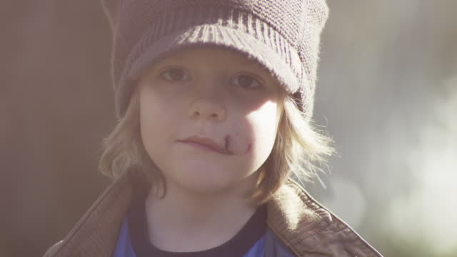 boy smiles into camera wearing hat - scar stock videos and b-roll footage