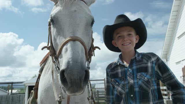 a boy smiles while a horse looks - rodeo stock videos & royalty-free footage