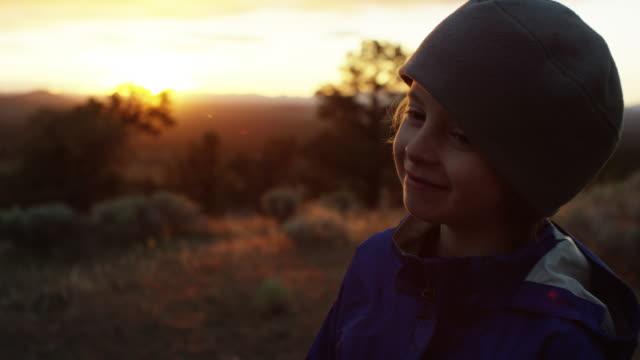 Boy smiles while camping