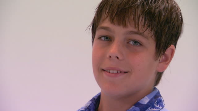 boy smiling for the camera - männlicher teenager allein stock-videos und b-roll-filmmaterial