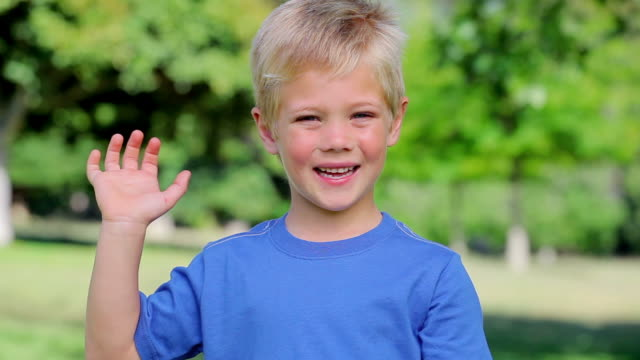 boy smiling and waving before giving the thumbs up - waving gesture stock videos & royalty-free footage