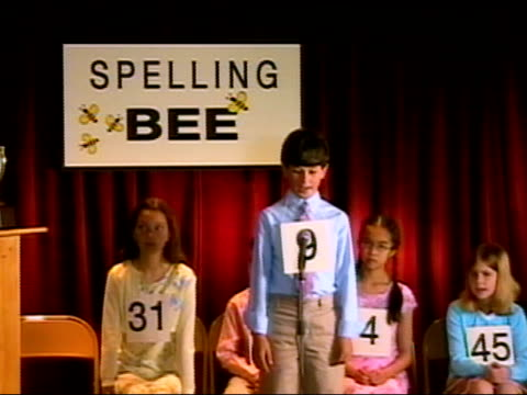 vídeos de stock e filmes b-roll de boy spelling word at microphone in spelling bee / sitting down / los angeles, california - sentar se