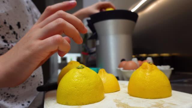 boy squeezing lemon - fruit juice stock videos & royalty-free footage