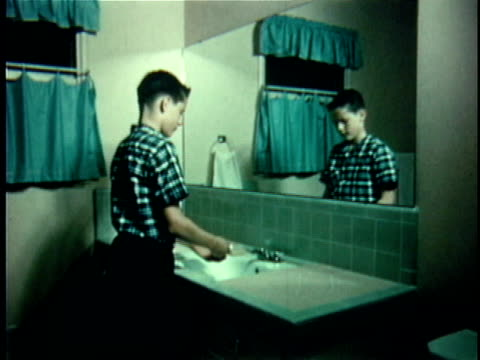 montage ms boy standing in front of bathroom mirror / cu boy washing his hands with soap in bathroom sink / usa - bar of soap stock videos and b-roll footage