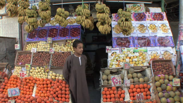 MS Boy standing outside fruit stall, Assyout, Egypt