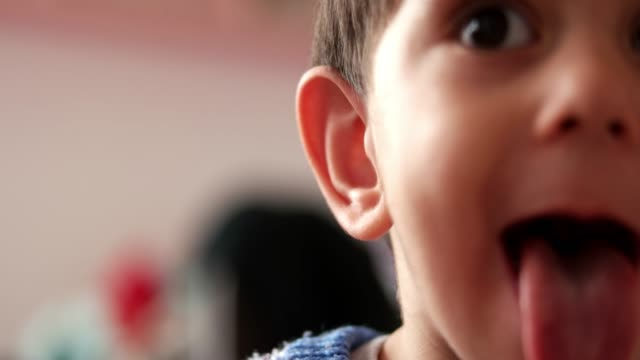 boy sticking tongue out - middle eastern ethnicity stock videos & royalty-free footage