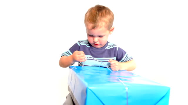 boy struggles with present - gift stock videos & royalty-free footage