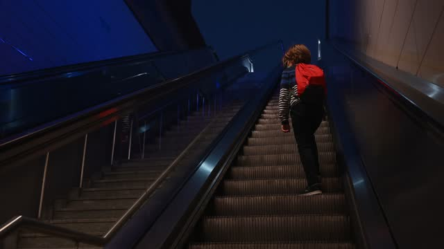 a boy student on the escalator of the subway. - homecoming stock videos & royalty-free footage