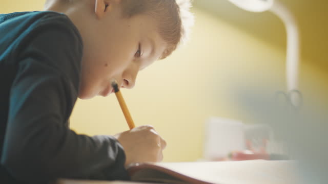 boy studying at table - children only stock videos & royalty-free footage
