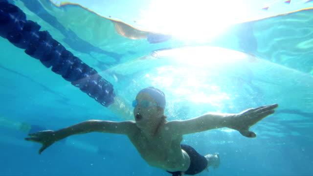 Boy swimming breaststroke