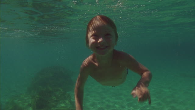 SLO MO, MS, Boy (6-7) swimming in ocean, Oahu's North Shore, Hawaii, USA