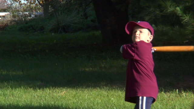 sm ms boy swinging at ball with baseball bat, missing ball, and running away/ chelsea, michigan - baseball bat stock videos & royalty-free footage