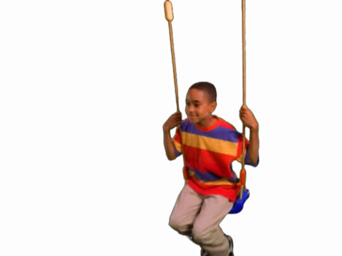 Boy swinging on swingset