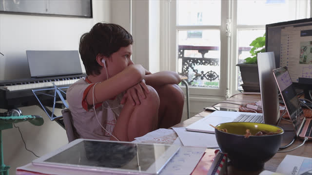 boy takes home video lesson, this boy is a middle school student, on april 26, 2021 in paris, france. the start of the school year after the school... - using laptop stock videos & royalty-free footage