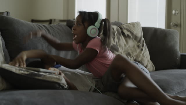boy taking digital tablet from sister who retaliates by hitting him / orem, utah, united states - aggression stock videos & royalty-free footage