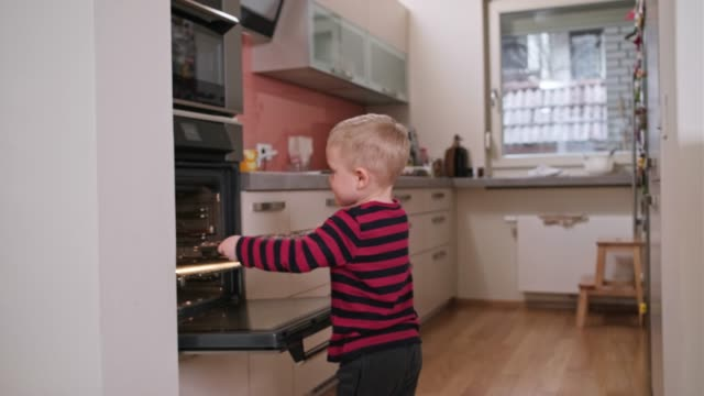 boy taking muffins to oven - baking tray stock videos & royalty-free footage