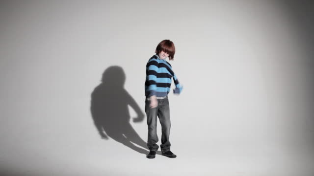 boy taking off sweater and walking away - pullover stock videos & royalty-free footage