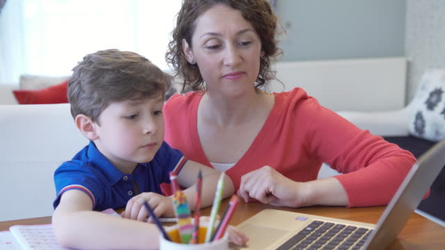 boy taking online courses in living room - single parent family stock videos & royalty-free footage