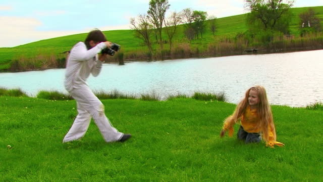 boy taking picture of girl. - artist's model stock videos and b-roll footage