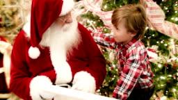 Boy talking to Santa